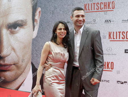 Boxer Vitali Klitschko and his wife Natalia pose during the premiere of the movie Klitschko in Essen, Germany, . The film directed by Sebastian Dehnhardt opens in Germany's cinemas on June 16, 2011