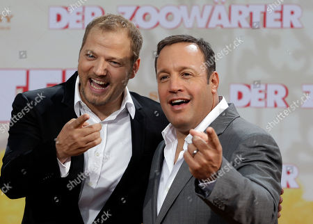 US actor Kevin James, right, and German comedian and voice actor Mario Barth who speaks the monkey Donald, left, pose for the photographers during the Europe premiere of the movie 'The Zookeeper' in Berlin, Germany