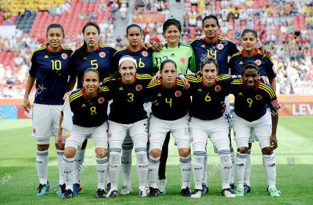 Colombia's Yoreli Rincon, Nataly Arias, Daniela Montoya, goalkeeper Sandra Sepulveda, Kelis Peduzine and Catalina Usme, back row from left, and front row from left, Andrea Peralta, Natalia Gaitan Diana Ospina,Daniela Montoya, Carmen Rodallega pose for during the group C match between Colombia and Sweden at the Women's Soccer World Cup in Leverkusen, Germany