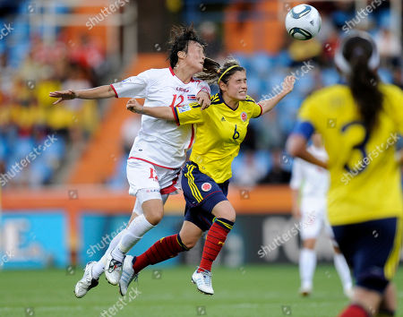 North Korea's Jon Myong Hwa challenges Colombia's Daniela Montoya during the group C match between North Korea and Colombia at the Women's Soccer World Cup in Bochum, Germany