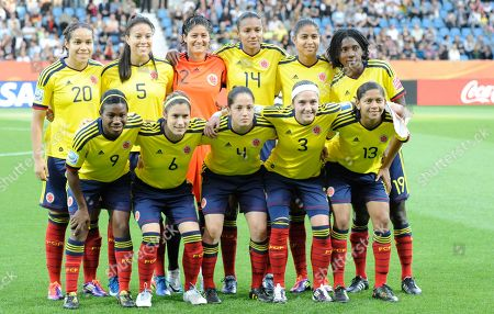 Colombia's Orianica Velasquez, Nataly Arias, goalkeeper Sandra Sepulveda, Kelis Peduzine, Katerin Castro, and Fatima Montano, from top left, and from bottom left, Carmen Rodallega, Daniela Montoya, Diana Ospina, Natalia Gaitan, and Yulieht Dominguez pose for a team photo just before the group C match between North Korea and Colombia at the Women's Soccer World Cup in Bochum, Germany