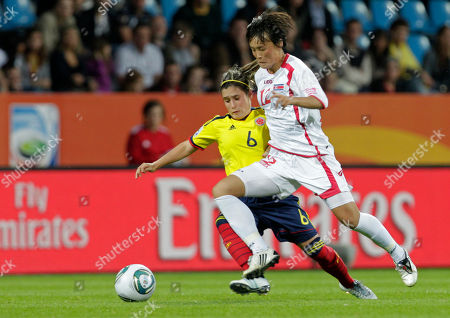 North Korea's Jon Myong Hwa and Colombia's Daniela Montoya, left, challenge for the ball during the group C match between North Korea and Colombia at the Women's Soccer World Cup in Bochum, Germany