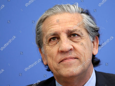 Spanish Secretary of State for the European Union, Diego Lopez Garrido, smiles during a news conference in Berlin, Germany