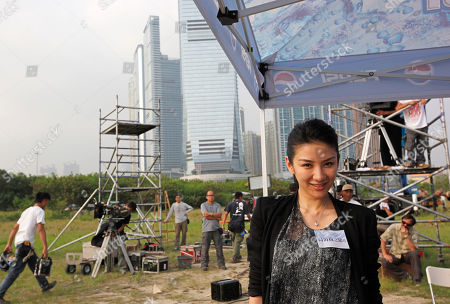 """Huang Yi Chinese actress Huang Yi poses for photographers during a film shoot of Hong Kong director Johnnie To's new movie """"Romancing in Thin Air"""" in Hong Kong, . To wrapped up the new romance in the southern Chinese financial center Thursday afternoon after what he and his producer described as a grueling filming in the high-altitude forests of southwestern Yunnan province"""