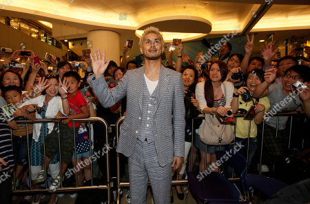 """Ken Hirai Japanese singer Ken Hirai poses in front of his fans at an event in Hong Kong . Hirai was promoting his new song album """"Japanese singer"""