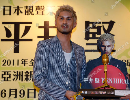 """Ken Hirai Japanese singer Ken Hirai poses at an promotional event for his new album """"Japanese Singer"""" in Hong Kong . Hirai struck a somber note, expressing solidarity with the victims of the March earthquake and tsunami as he promoted the new album in Hong Kong"""
