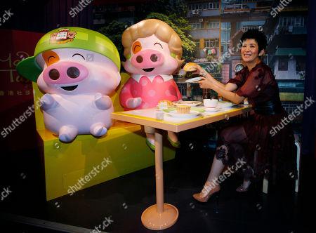 Sandra Ng Hong Kong actress Sandra Ng poses with the new wax figures of Hong Kong cartoon characters McDull, left, and his mother Madame Mak during their unveiling ceremony at Madame Tussauds in Hong Kong