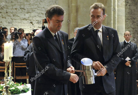 Georg von Habsburg, Karl von Habsburg Georg, left, and Karl von Habsburg, right, sons of Otto von Habsburg carry the urn containing his heart during the requiem in the Basilica of the Pannonhalma Abbey, in Pannonhalma, Hungary, . The oldest son of Austria-Hungary's last emperor and longtime head of one of Europe's most influential families died at age 98 on July 4. Otto von Habsburg was buried in Vienna, Austria, while his heart has been placed in Pannonhalma, Hungary