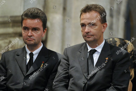 Georg von Habsburg, Karl von Habsburg Georg, left, and Karl von Habsburg, right, sons of Otto von Habsburg listen during the requiem before the burial of the urn containing the heart of Otto von Habsburg in the Basilica of the Pannonhalma Abbey, in Pannonhalma, Hungary, . The oldest son of Austria-Hungary's last emperor and longtime head of one of Europe's most influential families died at age 98 on July 4. Otto von Habsburg was buried in Vienna, Austria, while his heart has been placed in Pannonhalma, Hungary