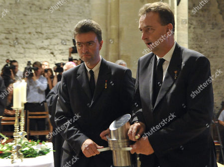 Georg von Habsburg, Karl von Habsburg Georg, left, and Karl von Habsburg, right, sons of Otto von Habsburg, right, carry the heart urn of Otto von Habsburg during the requiem at the Basilica of the Pannonhalma Abbey, in Pannonhalma, Hungary, . The oldest son of Austria-Hungary's last emperor and longtime head of one of Europe's most influential families died at age 98 on July 4. Otto von Habsburg was buried in Vienna, Austria, while his heart has been placed in Pannonhalma, Hungary