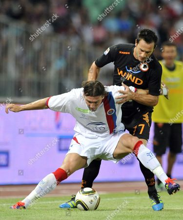 Marco Cassetti, Marko Simic AS Roma player Marco Cassetti, right, and FC Vasas player Marko Simic, left, fight for the ball during their friendly soccer match between Italy's AS Roma and Hungary's FC Vasas in Budapest, Hungary