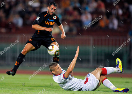 Simone Perrotta, Gabor Kovacs AS Roma player Simone Perrotta, left, and FC Vasas player Gabor Kovacs, right, fight for the ball during their friendly soccer match between Italy's AS Roma and Hungary's FC Vasas in Budapest, Hungary