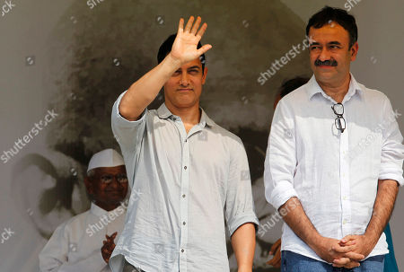 Anna hazare, Aamir Khan, Rajkumar Hirani Bollywood actor Aamir Khan waves to the crowd as Director Rajkumar Hirani, right, and India's anti-corruption activist Anna Hazare, back, look on during the 12th day of Hazare's fast against corruption in New Delhi, India, . Finance Minister Pranab Mukherjee warned lawmakers Saturday not to bypass India's constitution as they seek to resolve an impasse with Hazare who has demanded that they pass an anti-corruption bill