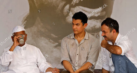 Anna hazare, Aamir Khan, Rajkumar Hirani India's anti-corruption activist Anna Hazare, left, drinks water as Bollywood actor Aamir Khan, center, and Director Rajkumar Hirani look on during the 12th day of Hazare's fast against corruption in New Delhi, India, . Finance Minister Pranab Mukherjee warned lawmakers Saturday not to bypass India's constitution as they seek to resolve an impasse with Hazare who has demanded that they pass an anti-corruption bill