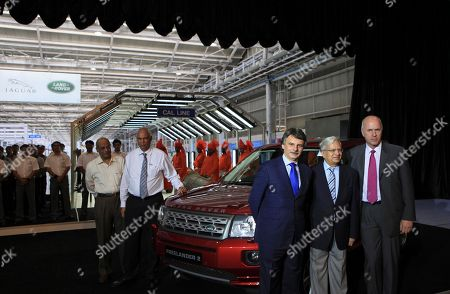 Carl Peter, Ravi Kant, Ralph Speth From right, Carl Peter, Forster Group chief executive officer and managing director Tata Motors Ltd., Tata Motors Vice Chairman Ravi Kant and Jaguar Land Rover Chief Executive Officer Ralph Speth, pose near a Land Rover car during the official opening of the Jaguar Land Rover (JLR) assembly plant in Pune, India, . Tata Group-owned luxury carmaker JLR in the day opened its first assembly plant in India