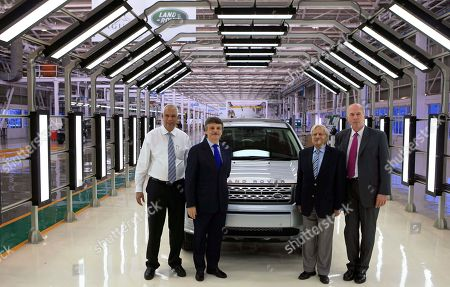 P.M. Telang, Ralph Speth, Ravi Kant, Carl Peter From left, Managing Director India Operation of Tata Motors Ltd. P.M. Telang, Chief Executive Officer Jaguar Land Rover Ralph Speth, Tata Motors Vice Chairman Ravi Kant and Carl Peter, Forster Group chief executive officer and managing director Tata Motors, pose near a Land Rover during the official opening of the Jaguar Land Rover assembly plant in Pune, India, . Tata Group-owned luxury carmaker Jaguar Land Rover (JLR) in the day opened its first assembly plant in India