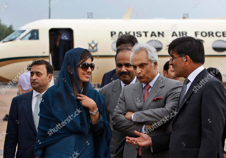 Stock Image of Hina Rabbani Khar, Sharat Sabharwal,Shahid Malik Pakistan's newly installed Foreign Minister Hina Rabbani Khar, second left is received by India's high Commissioner to Pakistan Sharat Sabharwal, right, as Pakistan's high commissioner to India Shahid Malik, second right, looks on at the airport in New Delhi, India, . Khar is here to meet with her Indian counterpart S.M. Krishna Wednesday. Indian and Pakistani officials began talks Tuesday against the backdrop of a recent terror attack that killed 20 people in India's financial capital