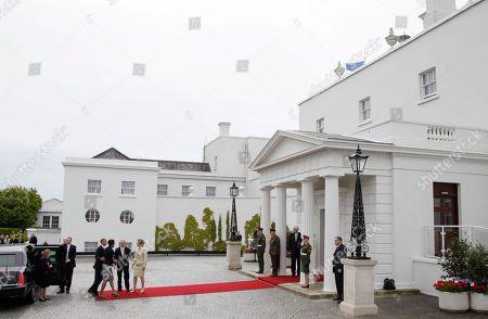 Barack Obama, Michelle Obama, Mary McAleese, Martin McAleese President Barack Obama and first lady Michelle Obama are greeted by the President of Ireland Mary McAleese and her husband Martin McAleese at the Presidential Residence in Dublin, Ireland