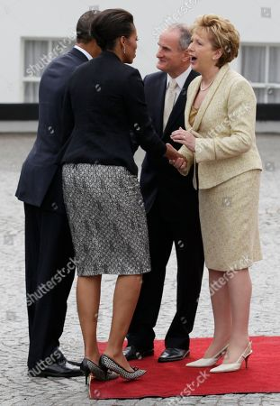 Barack Obama, Michelle Obama, Mary McAleese, Martin McAleese President Barack Obama and first lady Michelle Obama, left, are greeted by the President of Ireland Mary McAleese and her husband Martin McAleese at the Presidential Residence in Dublin, Ireland