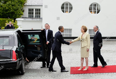 Barack Obama, Michelle Obama, Mary McAleese, Martin McAleese President Barack Obama is greeted by the President of Ireland Mary McAleese and her husband Martin McAleese at the Presidential Residence in Dublin, Ireland, . President Barack Obama opens a six-day European tour with a quick dash through Ireland, where he will celebrate his own Irish roots and look to give a boost to a nation grappling with the fallout from its financial collapse