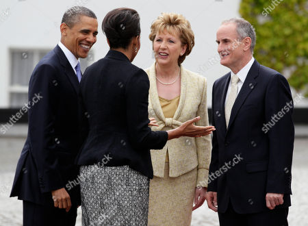 Barack Obama, Michelle Obama, Mary McAleese, Martin McAleese From left, President Barack Obama and first lady Michelle Obama are greeted by the President of Ireland Mary McAleese and her husband Martin McAleese at the Presidential Residence in Dublin, Ireland, . President Barack Obama opens a six-day European tour with a quick dash through Ireland, where he will celebrate his own Irish roots and look to give a boost to a nation grappling with the fallout from its financial collapse