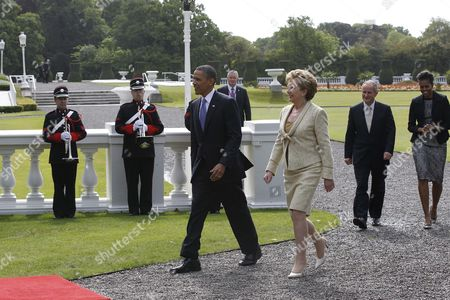 Barack Obama, Mary McAleese, Michelle Obama, Martin McAleese U.S. President Barack Obama and first lady Michelle Obama walk with Ireland's President Mary McAleese and husband Martin McAleese before a tree planting ceremony in Dublin, Ireland, .President Barack Obama opens a six-day European tour with a quick dash through Ireland, where he will celebrate his own Irish roots and look to give a boost to a nation grappling with the fallout from its financial collapse
