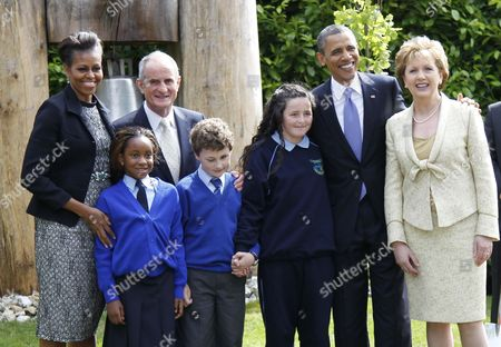 Barack Obama, Mary McAleese, Michelle Obama, Martin McAleese U.S. President Barack Obama and first lady Michelle Obama stand with Ireland's President Mary McAleese and husband Martin McAleese as they meet Irish school children at the Peace Bell during a tree planting ceremony in Dublin, Ireland, . President Barack Obama opens a six-day European tour with a quick dash through Ireland, where he will celebrate his own Irish roots and look to give a boost to a nation grappling with the fallout from its financial collapse