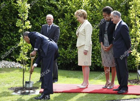 Barack Obama, Mary McAleese, Michelle Obama, Martin McAleese U.S. President Barack Obama and first lady Michelle Obama stand with Ireland's President Mary McAleese and husband Martin McAleese during a tree planting ceremony at the presidential residence in Dublin, Ireland
