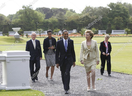 Barack Obama, Mary McAleese, Michelle Obama, Martin McAleese U.S. President Barack Obama and first lady Michelle Obama walk with Ireland's President Mary McAleese and husband Martin McAleese to a tree planting ceremony at the presidential residence in Dublin, Ireland