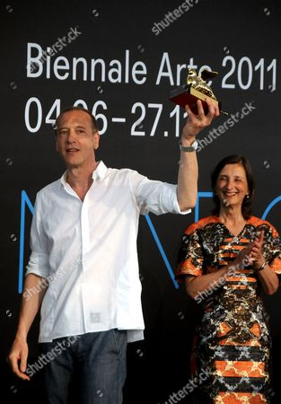 "Christian Marclay US artist Christian Marclay holds up the Golden Lion for for the best artist at the ILLUMInations Exhibition section, at the 54th International Art Exhibition ""La Biennale di Venezia"", in Venice, Italy"