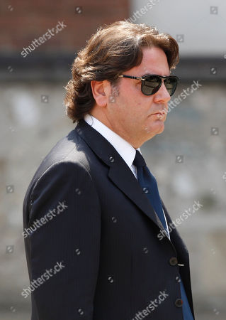 Stock Photo of Italian entrepeneur Stefano Ricucci arrives for Senator Romano Comincioli funeral at the Sant'Ambrogio church, in Milan, Italy, Wedneday