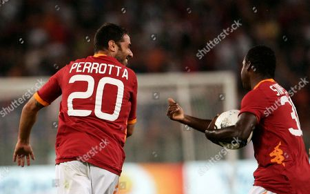 Simone Perrotta, Fabio Simplicio AS Roma midfielder Simone Perrotta, left, celebrates with teammate Fabio Simplicio, of Brazil, after scoring during a UEFA Europa League playoff second leg soccer match against Slovan Bratislava, at Rome's Olympic stadium