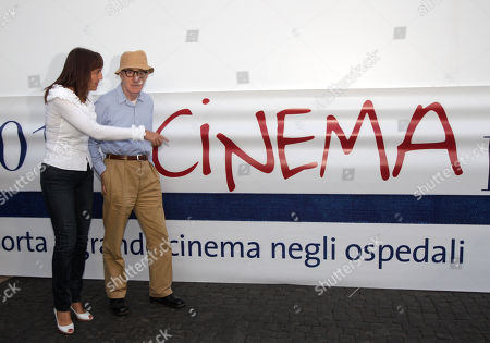 """US Director Woody Allen, right, and Rome province president Renata Polverini inaugurate an open air cinema set up at the Forlanini hospital, in Rome, . Woody Allen is in Rome for the shooting of his latest movie """"The Bop Decameron"""
