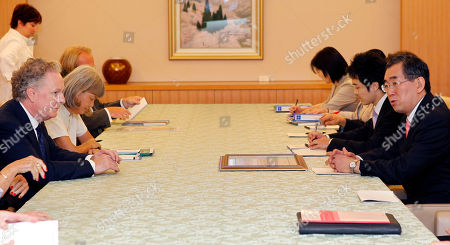 Stock Image of Jean Charest, Takeaki Matsumoto Quebec Premier Jean Charest of Canada, left, listens to Japanese Foreign Minister Takeaki Matsumoto, right, during their meeting in Tokyo