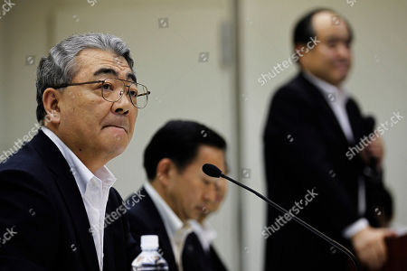 Toshio Nishizawa Toshio Nishizawa, left, president of Tokyo Electric Power Co., listens to a reporter's question during its press conference at the headquarters in Tokyo . The utility behind the unfolding Japanese nuclear disaster reported a 571.7 billion yen ($7.4 billion) quarterly loss and its president is expecting the red ink to swell further over restoration and compensation costs