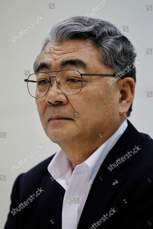 Toshio Nishizawa Toshio Nishizawa, president of Tokyo Electric Power Co., listens to a reporter's question during its press conference at the headquarters in Tokyo . The utility behind the unfolding Japanese nuclear disaster reported a 571.7 billion yen ($7.4 billion) quarterly loss and its president is expecting the red ink to swell further over restoration and compensation costs
