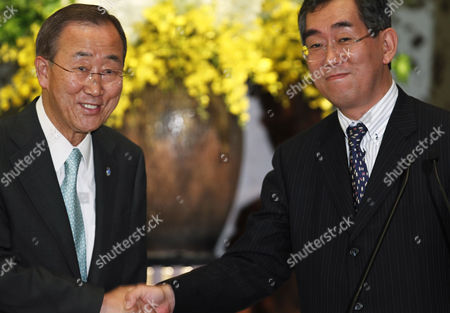 Ban Ki Moon, Takeaki Matsumoto U.N. Secretary-General Ban Ki-moon, left, and Japan's Foreign Minister Takeaki Matsumoto pose for photos as they shake hands at the end of a press conference in the guesthouse of the ministry in Tokyo . U.N. Secretary-General Ban said Japan promised Monday to share invaluable lessons of disaster management and nuclear safety that it learned from March's disasters