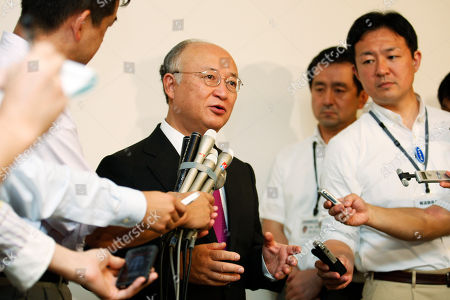 Yukiya Amano Yukiya Amano, center, director general of the International Atomic Energy Agency (IAEA), answers a question after meeting with Tokyo Electric Power Co. (TEPCO) Chairman Tsunehisa Katsumata and President Toshio Nishizawa, at TEPCO headquarters in Tokyo