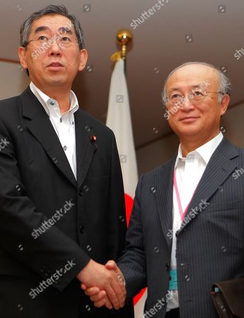 Yukiya Amano, Takeaki Matsumoto International Atomic Energy Agency Director General Yukiya Amano, right,shakes hands with Japanese Foreign Minister Takeaki Matsumoto prior to their meeting at Foreign Ministry in Tokyo, Japan, . Amano, on a week-long trip to Japan, said Monday that Japan's tsunami-hit nuclear plant is steadily making progress to contain damage from the crisis