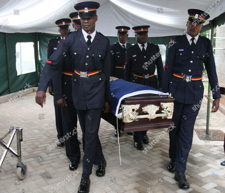Kenya police officers carry the coffin containing the body of the late Kenyan runner Sammy Wanjiru at a funeral home in Nairobi, Kenya, on . Wanjiru, who set a blistering pace to shatter the 24-year-old Olympic record in the marathon, died on May 15 in Nyahururu, Kenya