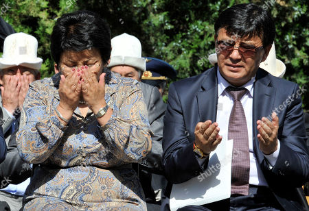 Roza Otunbayeva Kyrgyzstan's President Roza Otunbayeva, left, prays during a ceremony marking the first anniversary of a deadly wave of violence between ethnic Kyrgyz and minority Uzbeks in the southern city of Osh, Kyrgyzstan, . Riots broke out in Osh on June 10 2010, and culminated in pogroms against Uzbek neighborhoods. At least 470 people, mostly ethnic Uzbeks, were killed and some 400,000 fled their homes