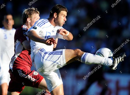 Dekel Keinan, Artjoms Rudnevs Latvia's Artjoms Rudnevs, left, fights for the ball against Israel's Dekel Keinan during their Euro 2012 Group F qualifying match in Riga, Latvia