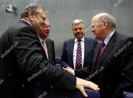 Evangelos Venizelos, Michael Noonan, Didier Reynders, Jean-Claude Juncker From left, Greek Finance Minister Evangelos Venizelos, Luxembourg's Finance Minister Jean-Claude Juncker, Belgian Finance Minister Didier Reynders and Irish Finance Minister Michael Noonan share a word during a meeting of eurozone finance ministers in Luxembourg on . On only his third day in office, Greece's new Finance Minister Evangelos Venizelos faces his first big test: He must convince his eurozone counterparts to release a loan installment his country needs to avoid defaulting on its massive debts next month, and to commit to billions in new loans to keep Greece afloat in the coming years