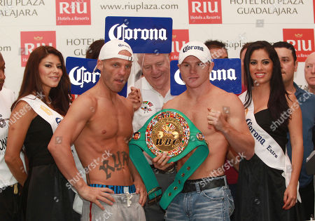 "Saul Alvarez, Ryan Rhodes Mexican WBC light-middleweight champion Saul ""Canelo"" Alvarez, second right, poses while holding his title belt during the weigh in ceremony with his challenger UK's boxer Ryan Rhodes, second left, in Guadalajara, Mexico, . Both will face off Saturday in Guadalajara"