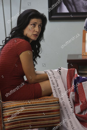 """Stock Picture of Leticia Huijara Mexican actress Leticia Huijara, who plays the part of Isabel Sanmillan, rehearses a scene on the set of the soap opera """"Eighth Commandment"""" at Argos Production studios in Mexico City. While Americans prepare to mark the 10th anniversary of the Sept. 11 attacks, many Mexicans are remembering the event through the six-month-long series that traces the aftermath of the tragedy on both sides of the U.S.-Mexico border. The commandment mentioned in the title, which in the Catholic version preaches """"Thou shall not bear false witness against your neighbor,"""" references a journalist's duty to tell the truth, something both mother and daughter in the series pay high prices for doing, both against the U.S. and Mexican governments but also drug traffickers"""