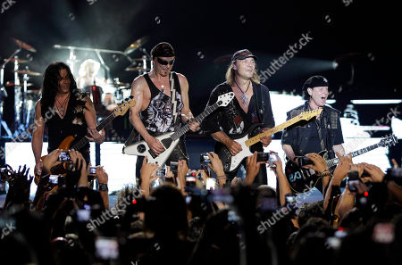 From right to left, Singer Klaus Meine, guitarists Matthias Jabs, Rudolph Schenker, Pawel Maciwoda, of the German rock band Scorpions as they perform during a concert at Byblos International Festival in the ancient city of Byblos, north of Beirut, Lebanon
