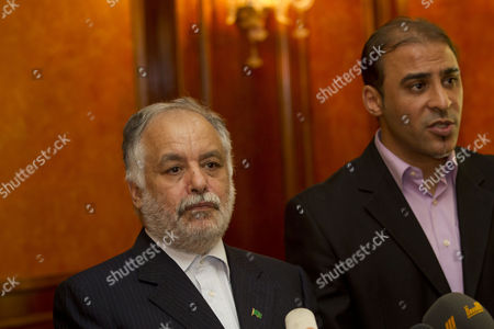 Stock Photo of Libya's Prime Minister, Al-Baghdadi Ali Al Mahmoudi, left, pauses while Libyan government spokesman Moussa Ibrahim translates during a news conference in Tripoli, Libya, . al-Mahmoudi says the government was in negotiations with rebels