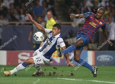 Eric Abidal, Givanildo Vieira de Souza Hulk Barcelona's French defender Eric Abidal, right, challenges Porto's Brazilian forward Givanildo Vieira de Souza Hulk for the ball, during their UEFA Super Cup final soccer match, in Monaco. Barcelona says Thursday March 15, 2012, defender Eric Abidal will have a liver transplant in the coming weeks. Last year, Abidal had a tumor removed from his liver