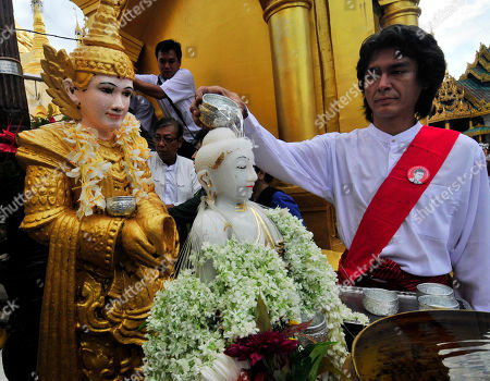 Kim Aris Kim Aris, youngest son of Myanmar democracy icon Aung San Suu Kyi, pours water to a marble Buddha statue as an act of merit during his visit at the Shwedagon pagoda together with his mother in Yangon, Myanmar