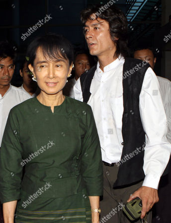 Aung San Suu Kyi, Kim Aris Myanmar democracy icon Aung San Suu Kyi, left, and her youngest son Kim Aris walk as she sees off her son at Yangon International Airport Tuesday, July 12,2011, in Yangon, Myanmar
